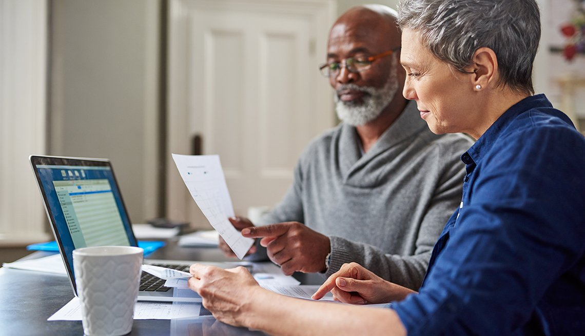 Couple work on finances at home