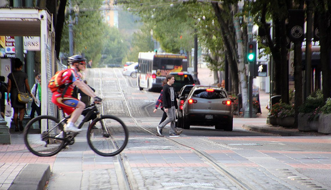 Bicyclist Crosses Road, Cobblestones, Bus, AARP, Public Policy Institute, Livable Communities, Transportation