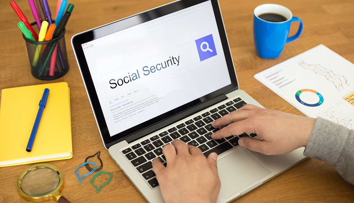 A laptop showing search results for Social Security on the screen