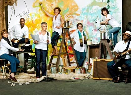 group of creative people in front of painting