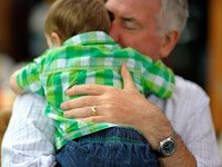 Grandfather holding baby grandson