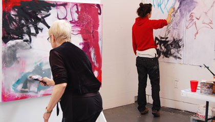 Expressive Drawing-two students work on their art projects in a studio