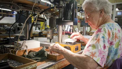 Rosa Finnegan working at Vita Needle company primarily composed of senior citizens.