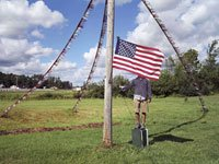 Boy standing behind flag - patriotism