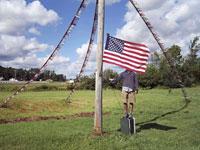 Boy standing behind flag - patriotism