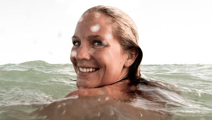 Woman swims in the open ocean water - heaven on earth