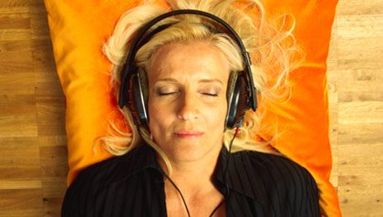 woman listening to music on head phones