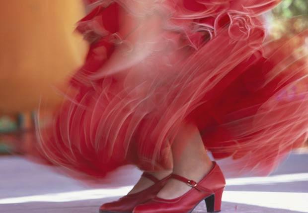 Mujer bailando flamenco - sea usted una prioridad