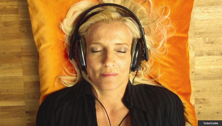 woman listening to music on head phones