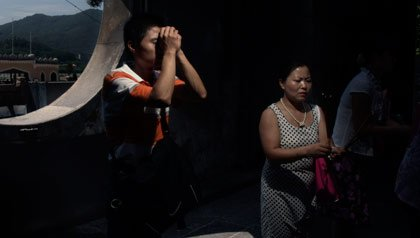 People pray at a temple in China.