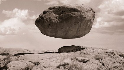 Levitating rock representing belief in miracles