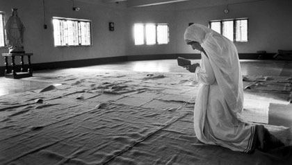 The late Mother Teresa prays in Calcutta, India, in 1989.
