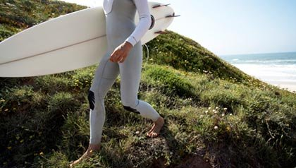 Woman getting ready to surf