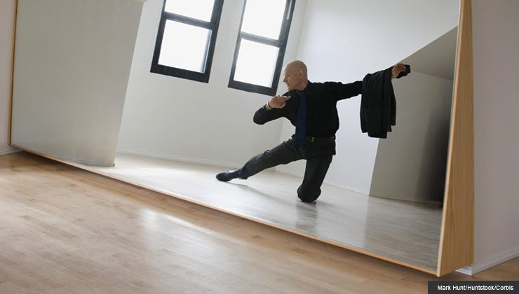 Man dances the tango in a room by himself.