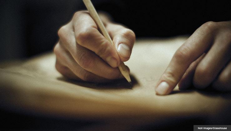 Man writing a mission statement