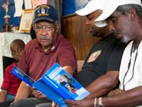Lawrence McRae chatting in a barbershop about prostate health