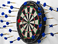 dart board with lots of missed darts