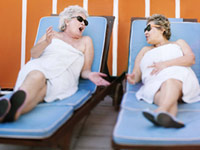 Women enjoying each other's company on lounge chairs - Interview Wendy Lustbader, author of Life Gets Better: The Unexpected Pleasures of Growing Older