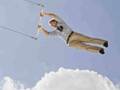 Man on flying trapeze experiencing Marc Freedman's Big Shift after midlife