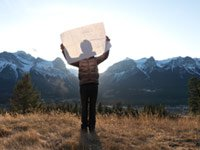 What is your dream- a man stands on top of a mountain holding architectural plans