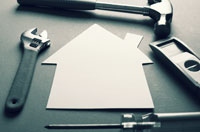 AARP Long Term Care Tips about how to plan Your Home, your Community, and your Future- a paper cutout of a house surrounded by tools