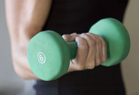 8 Ways to Stay Healthy- a woman exercises with a hand weight