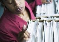 A woman checks her medical history records and files