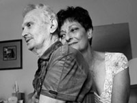 woman hugging a man - uncompensated caregiving costs have climbed to $450 billion annually