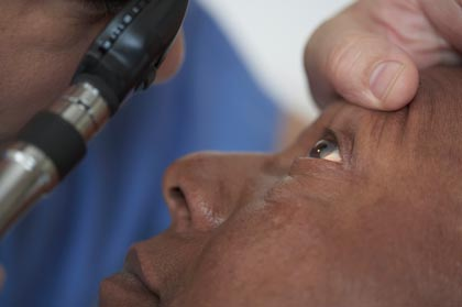 Senior African American man having his eyes examined in a doctor's office