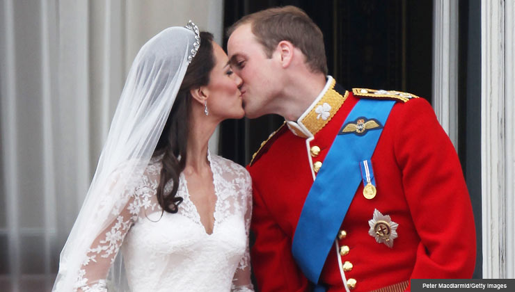 LONDON, ENGLAND - APRIL 29: Their Royal Highnesses Prince William, Duke of Cambridge and Catherine, Duchess of Cambridge kiss on the balcony at Buckingham Palace on April 29, 2011.