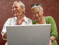 Senior couple communicates through social media on the computer