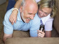 Grandparents guide how to social network with grandkids - couple on a sofa.