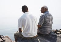 Father and son on rocks by water-how to help adult unemployed children