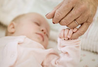 grandparents guide to childproofing holding baby finger