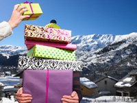 AARP 2011 Holiday Gift Guide- a man holds a stack of christmas presents