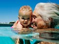 grandma with baby granddaughter in pool, 10 things to love about being a grandma