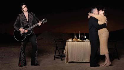 Couple embracing at a candlelight dinner with a crooner - innovative and inexpensive ways to express affection