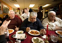 Manny Alfano, left, Charles Sousa, center, and Gene Antonio of the ROMEO club dine at La Sicilia in Belleville, N.J.