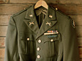 U.S. Army uniform coat in closet