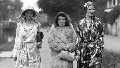 Details such as clothing, hats, shoes, and hairstyles can help you establish a date for old photos- three women walk on a canal in 1931