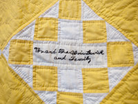 closeuTracee Hamilton of Vienna VA with a closeup of family quilt that hangs in the stairwell.p of Tracee Hamilton's family quilt