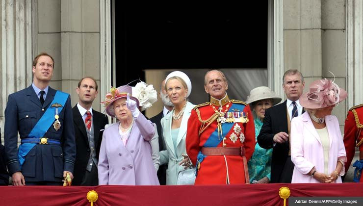 The British Royal Family including Prince William (L) Camilla (R), The Duchess of Cornwall stand alongside Queen Elizabeth II (centre L) and her husband Prince Phillip, The Duke of Edinburgh, as they watch a flypast from the balcony of Buckingham Palace, June 12, 2010.