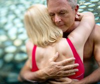 Couple embrace in a pool-Sex is healthy for older men