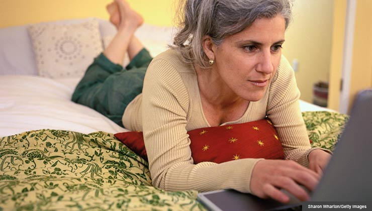 Woman Using Laptop Computer At Home-4238