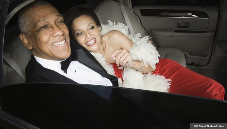 tips for the newly single, couple hugging and smiling in limousine
