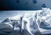 Sábanas destendidas en la cama