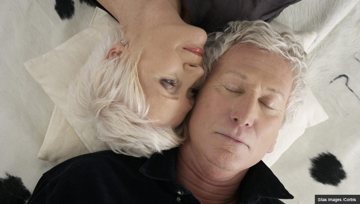 Mature man and woman with heads together