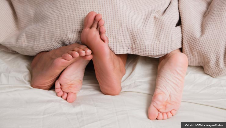 Feet under covers in bed