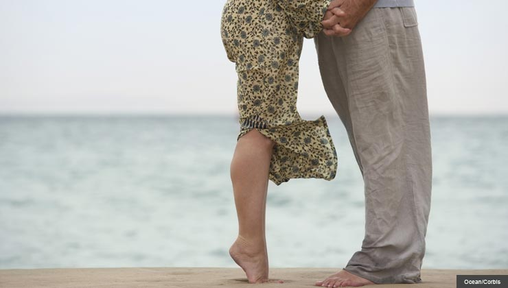 Low angle of couple on beach-4 Ways to Have Better Sex