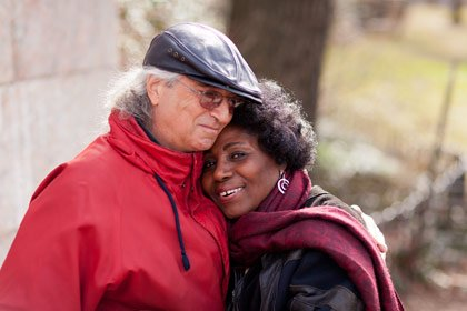 Chris and Minerva Warwin, an interracial couple, walk in Riverside Park in New York City.